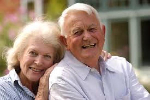 elderly wife hugs husband
